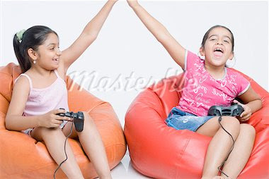 girls on couch video games high five