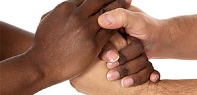 black hand holding white hand