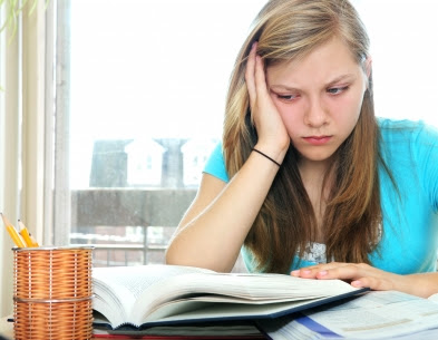 unhappy teenager reading