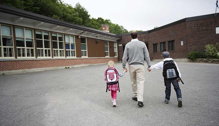 child man walking to school