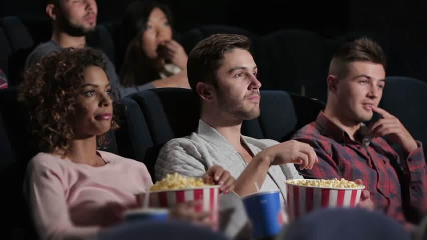 watching movie popcorn